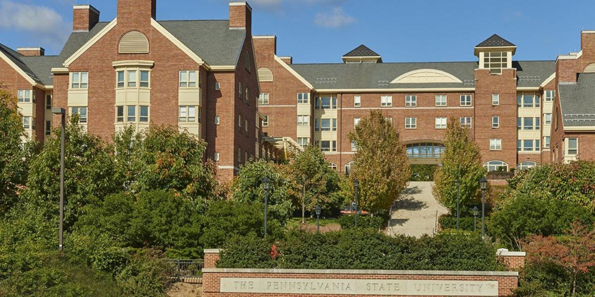front view of residence hall with Penn State letters